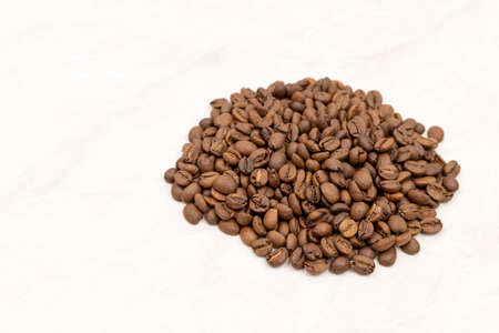 Pile Of Coffee Beans Isolated Above White Background. 免版税图像