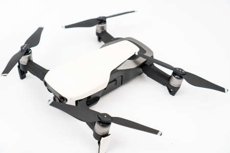 White drone quadcopter isolated above white background.