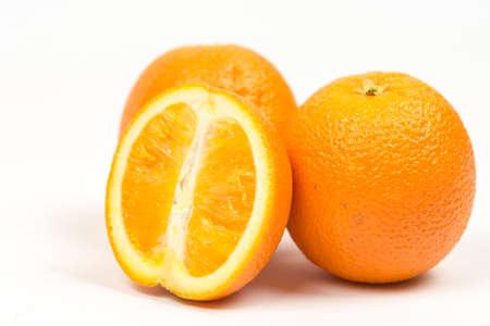 Three sliced oranges isolated over white background. Stock Photo