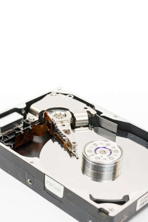 Inside opened pc hard disc isolated over white background.