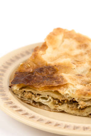 Traditional burek pie with meat isolated over white background. Stock fotó