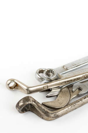 Old used wrench tools isolated over white background with copy space.