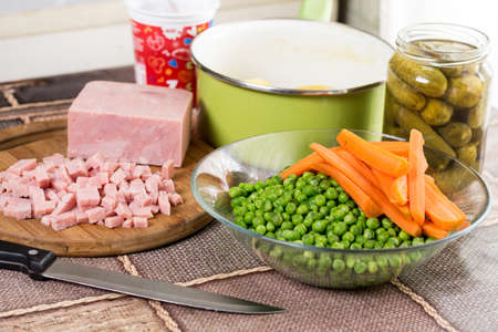Chopped ham with cooked green peas carrot and potatoes.
