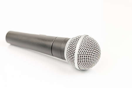 Vocal microphone isolated above white background. Music concept with singing microphone.