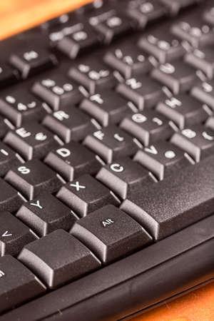 Closeup macro black unused pc keyboard keys.