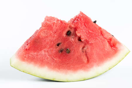 Slices of watermelon isolated above white background.