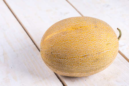 Fresh melon on the wooden board table.