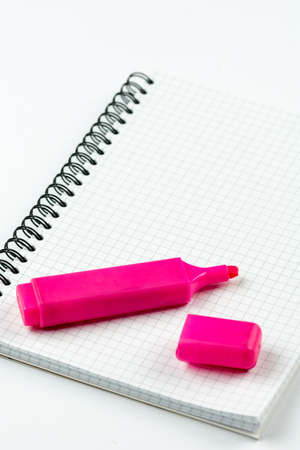 Red felt pen on the school notebook with copy space above white background.