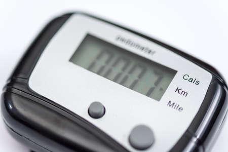Pedometer over white background Stock Photo