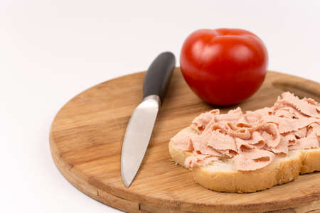 Chicken liver pate homemade sandwich and tomato.