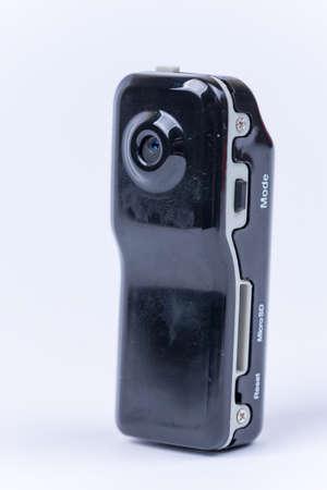 Mini spy hidden camera over white background.