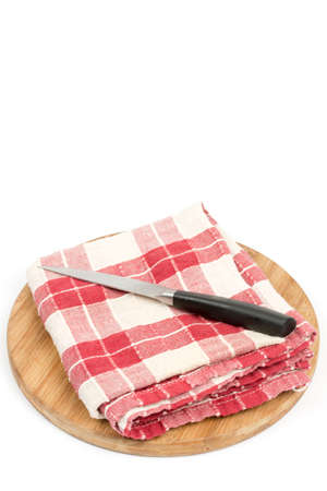 Kitchen red white cloth with knife and wooden board. Stock Photo