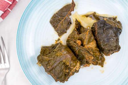 Minced meat rolls in Chard served on the plate. Traditional balkan meal made with chard and minced meat