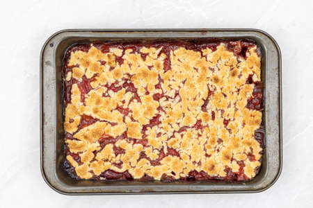Top view of Strawberry cake baked in the baking tray.