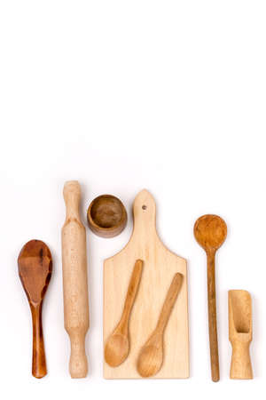 Kitchen wooden cutting board and wooden spoons flat lay