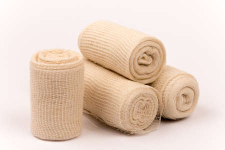 Bunch of new bandage rolls over white background Stock Photo