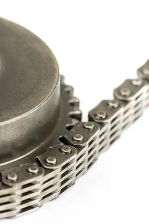 Closeup macro used oiled timing chain with cam shaft 免版税图像
