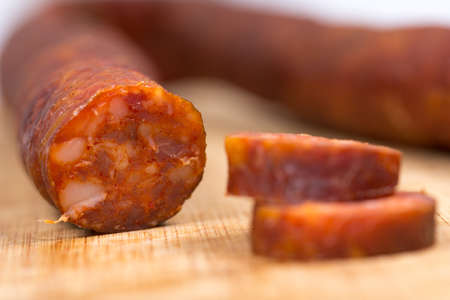 Domestic raw smoked sausages on the table Stock Photo