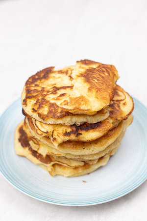 Top view of stacked pancakes served on the plate.