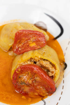 Stuffed paprika with minced meat and served on the plate.