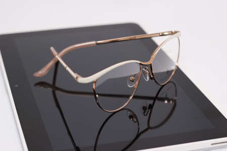 diopter: glasses with diopter, and the tablet on white background