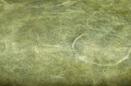 Abstract green leather texture, can be used as a background. alcantara.