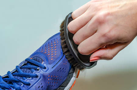 Cleaning dirty sneakers after training. Wash dirty sneakers. Wash your sneakers. Cleaning your trail running shoe