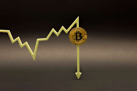 Bitcoin price. Fluctuations and forecasting of the cryptocurrency rate. Bitcoin coin on the price chart points down. on black background, copy space