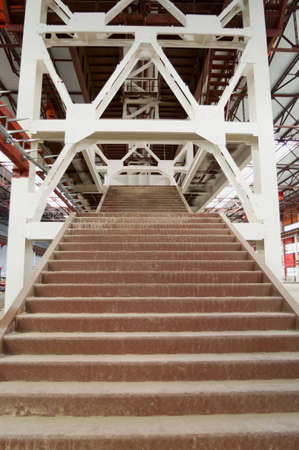 to sway: Steel staircase with metalware, sway bracing and flight of stairs.