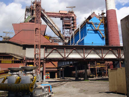 Metallurgical works with blast furnaces, chimney flue and railway in Rissia Stock Photo - 4663950