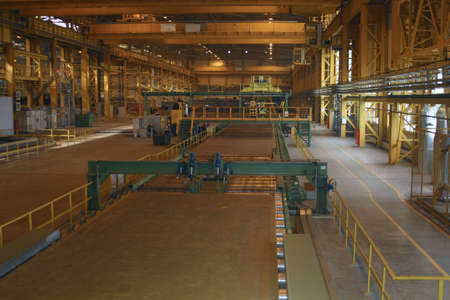 Sheet mill in ferrous metallurgy work produces sheets of steel. photo