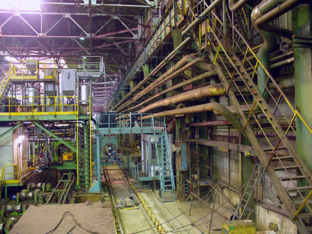 ferrous: Cold rolling department in ferrous metallurgy factory with hardware under roof and forming rolls. Stock Photo