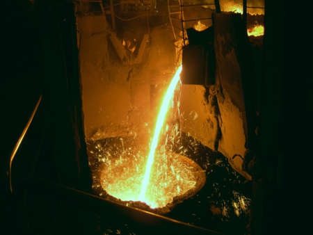 Liquid metal from casting ladle. Ferrous metallurgy.