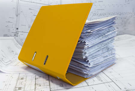 Big heap of design and project drawings in yellow folder on the table surface. White whatman are background. Stock Photo - 4806316