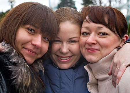 Three women stay together with another. Portraits. They are caucasian. Friends. Stock Photo - 5064540