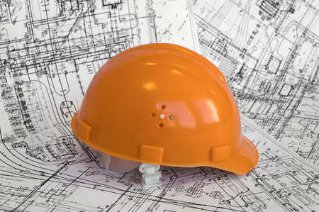 Orange helmet lies on the project drawings Stock Photo - 5121021