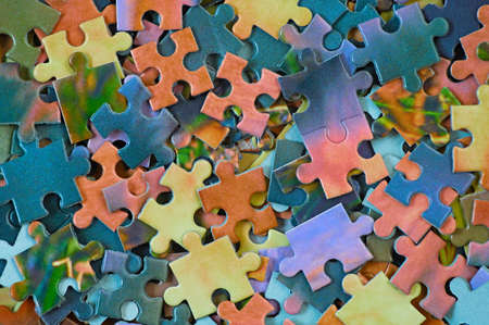 Background from parts of puzzle. Pile color mosaics Stock Photo - 5121033