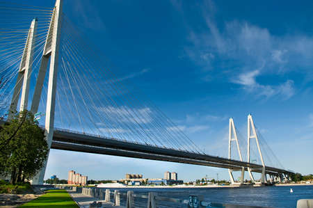 neva: Cable-braced bridge across the river Neva, Russia, St. Petersburg. Blue sky with clouds.