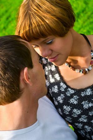 Teenagers: girl and fellow embracing one another. Close up portrait Stock Photo - 5254193