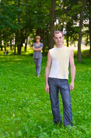 Teenagers: woman stands behind man. It is on nature. Full-length portrait Stock Photo - 5265495
