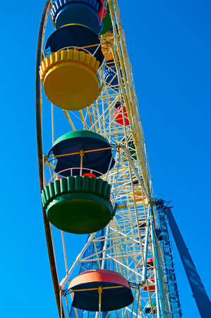 Big ferris wheel against blue sky background photo