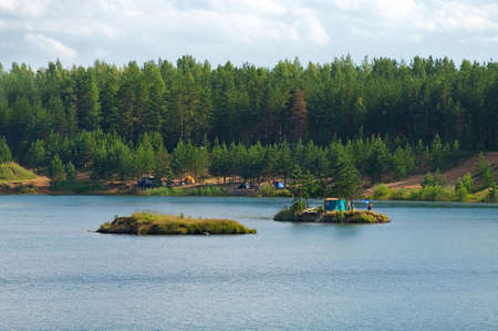overnight stay: Tourists on island in the middle of a  blue lake Stock Photo