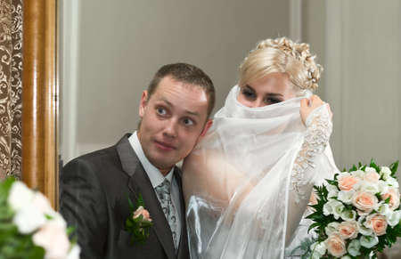 Loving wedding couple looking in mirror  photo