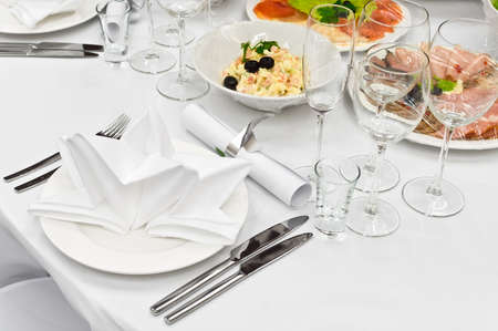 Table appointments for dinner in restaurant. Detail of a fancy table set for holiday dinner Stock Photo - 6231878