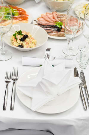 wedding table setting: Table appointments for dinner in restaurant. Detail of a fancy table set for holiday dinner Stock Photo