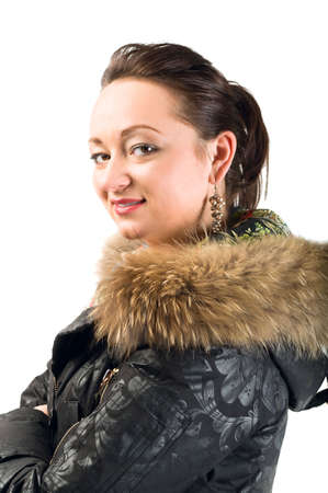 Young beautiful woman in jacket with fur looking on camera. Isolated over white background photo