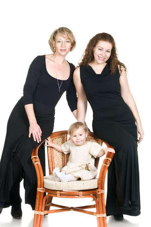 Three generations: mature grandmother, young mother and little daughter. Isolated over white background Stock Photo - 6429574