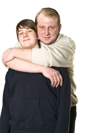 Father and son a teenage are embracing. Isolated on white background. Studio shot Stock Photo - 6535670