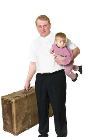 Father playing with little child. Man holding baby underarm. Ancient big suitcase in other hand. Isolated on white background. photo
