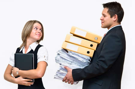 helps: Businessman helps a businesswoman to carry stack of documents. Two office white collar people. Isolated on white background